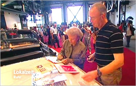 Hans gets an autograph from Maria Elena Holly