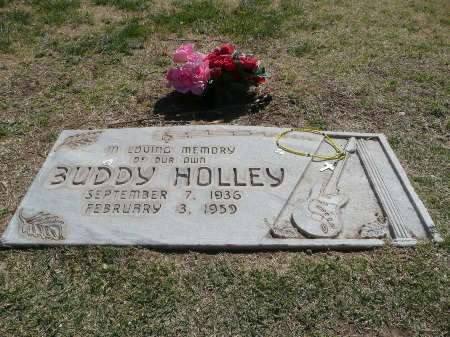Buddy's grave with some flowers